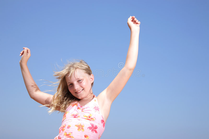 Happy girl. Over sky background stock photography