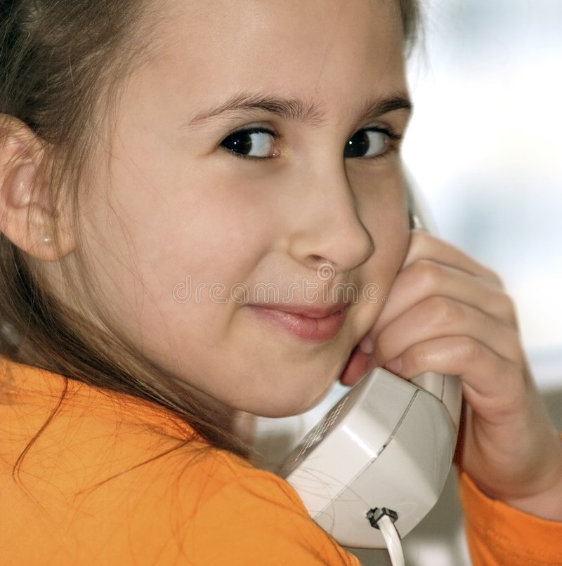 Happy girl with analog phone. In home stock image
