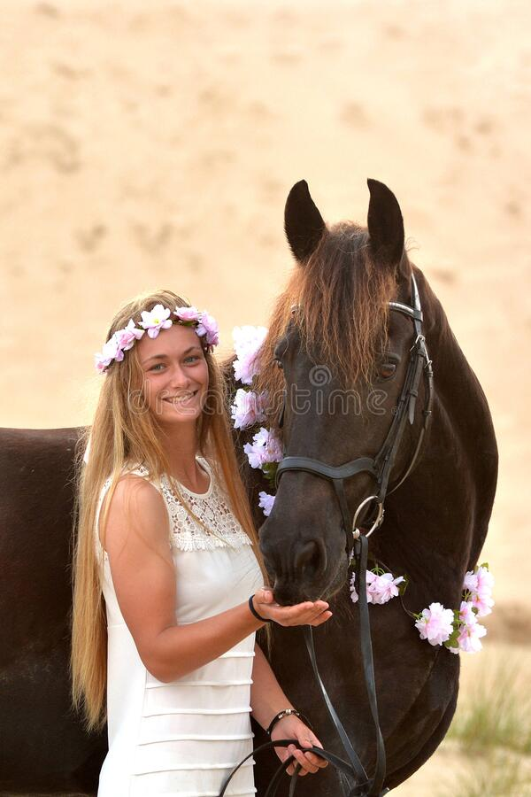 Free Happy Girl And Her Black Frisian Horse Stock Images - 181379794