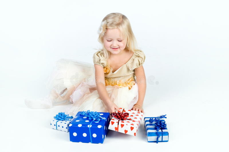 Happy Girl Arranging Presents Royalty Free Stock Photo