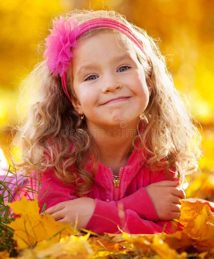 Happy girl in autumn park stock photography
