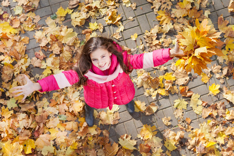Happy girl in autumn park royalty free stock photography
