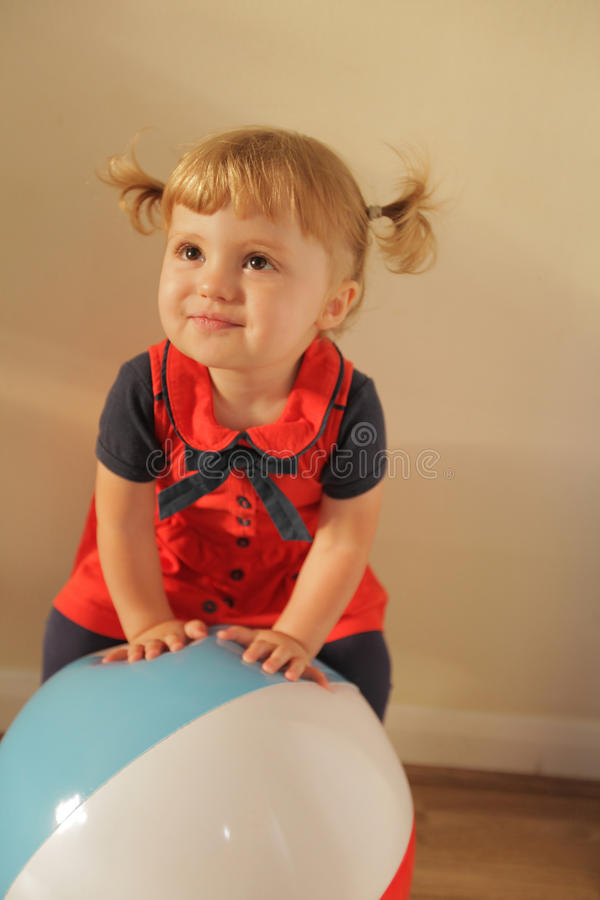Happy girl with a ball stock photos