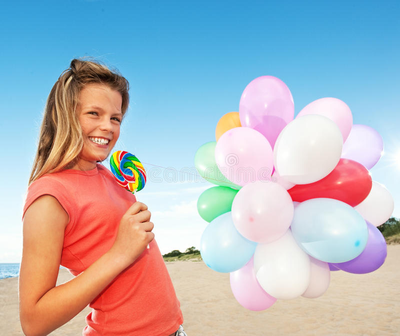 Download Happy girl with balloons stock photo. Image of childhood - 10316058