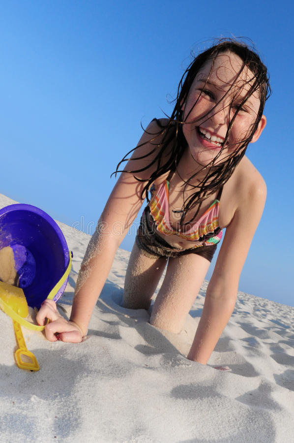 Happy girl on beach stock photography