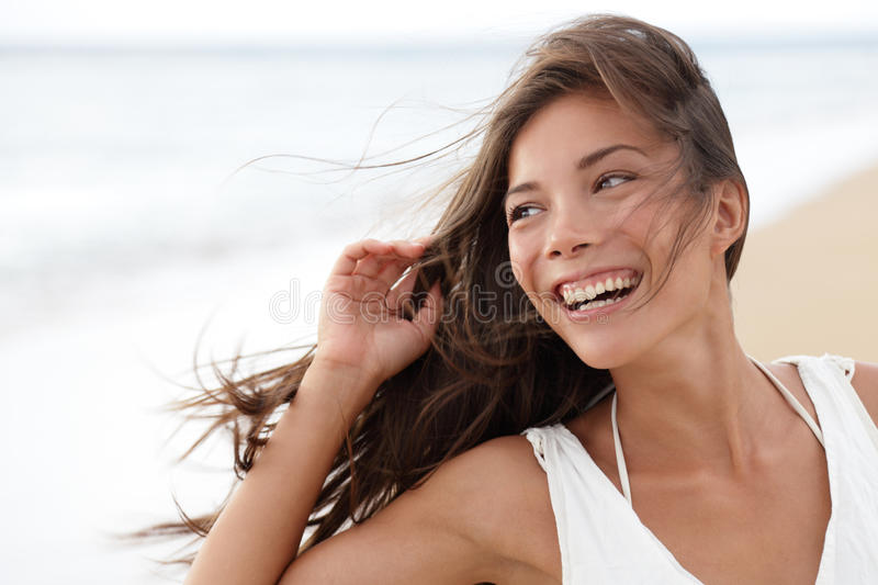 Happy girl on beach - candid young woman joyful stock image