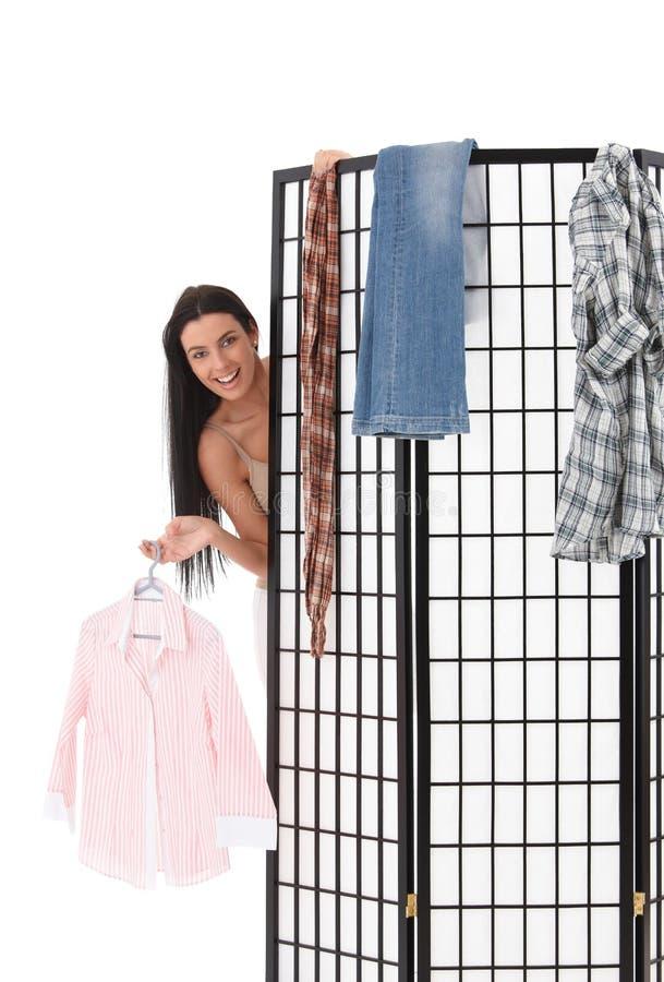 Happy girl behind dressing panel