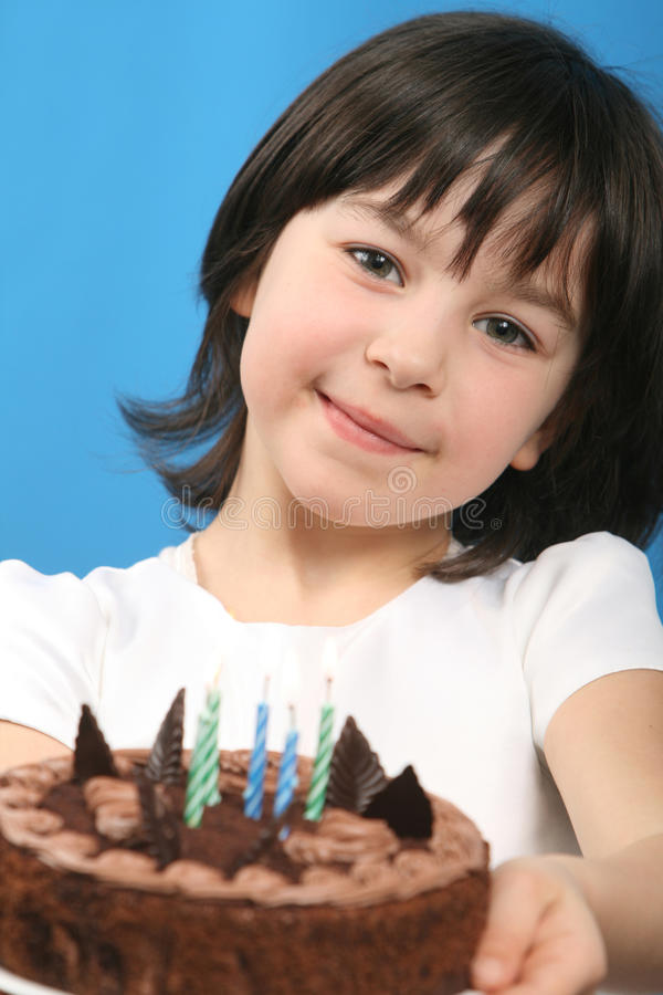 Happy girl with birthday cake. Studio shot royalty free stock images