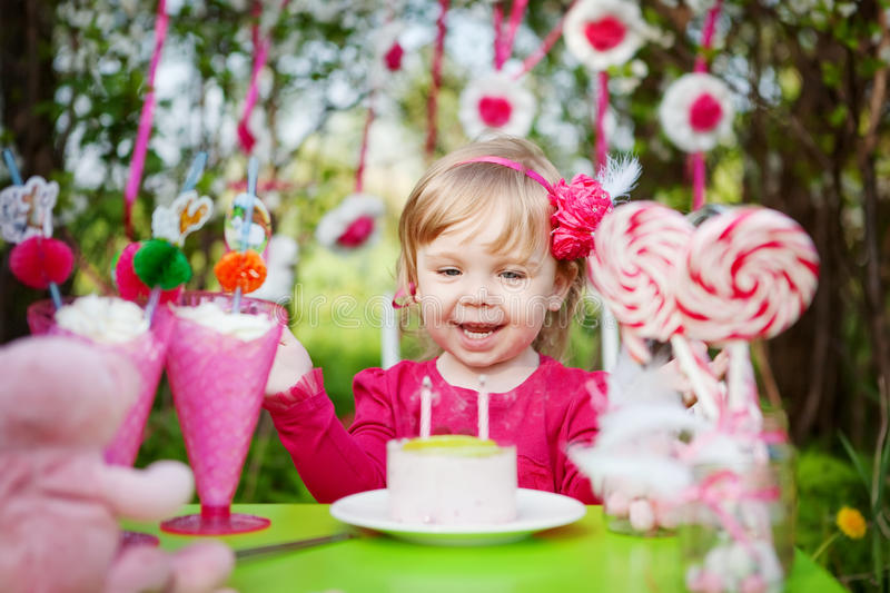 Happy girl with birthday cake. Outdoors royalty free stock photos