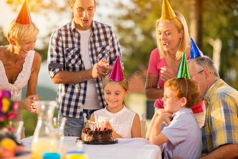 Happy girl with birthday cake royalty free stock photography