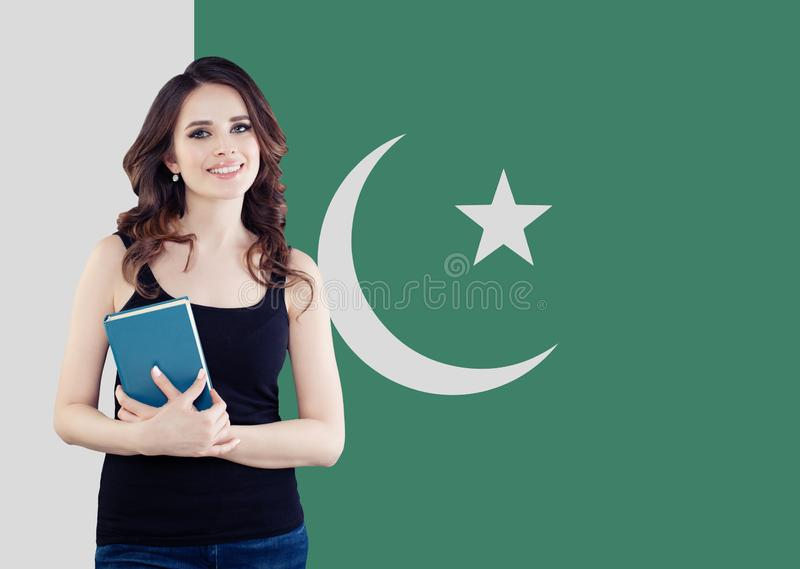 Happy girl with book. Young woman student smiling stock photo