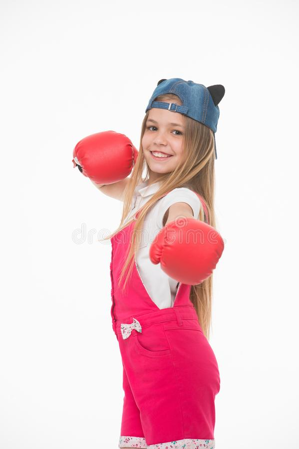 Happy girl in boxing gloves isolated on white. Little child smile before training or workout. Kid athlete in fashionable royalty free stock image