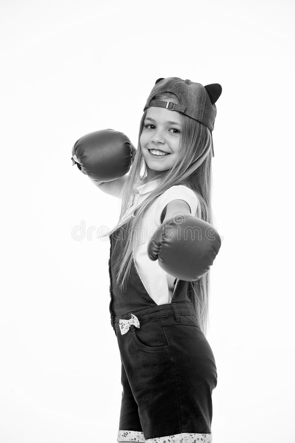 Happy girl in boxing gloves isolated on white. Little child smile before training or workout. Kid athlete in fashionable. Cap. Fashion, style and trend. Sport royalty free stock photos