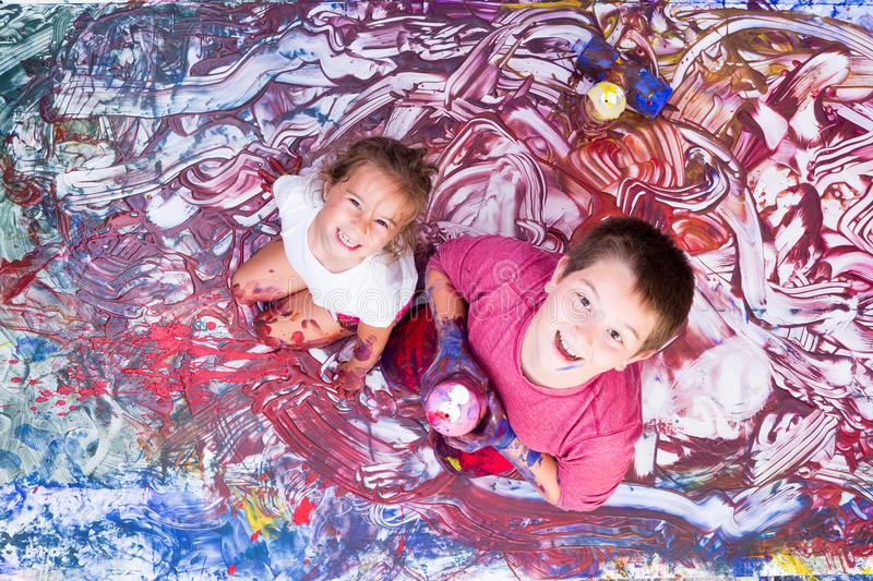 Happy girl and boy painting with their hands royalty free stock photos
