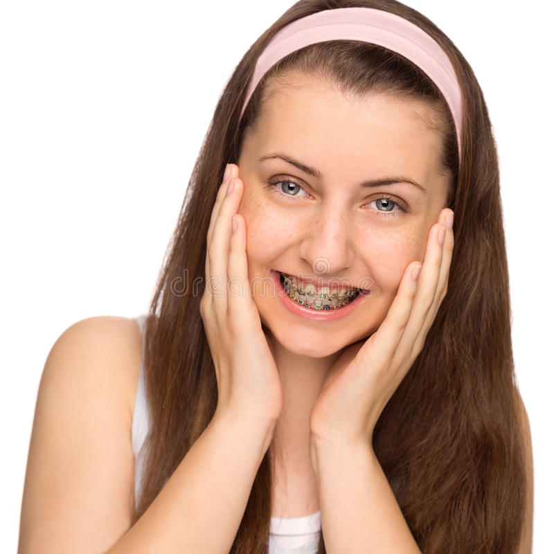 Happy girl with braces isolated stock image