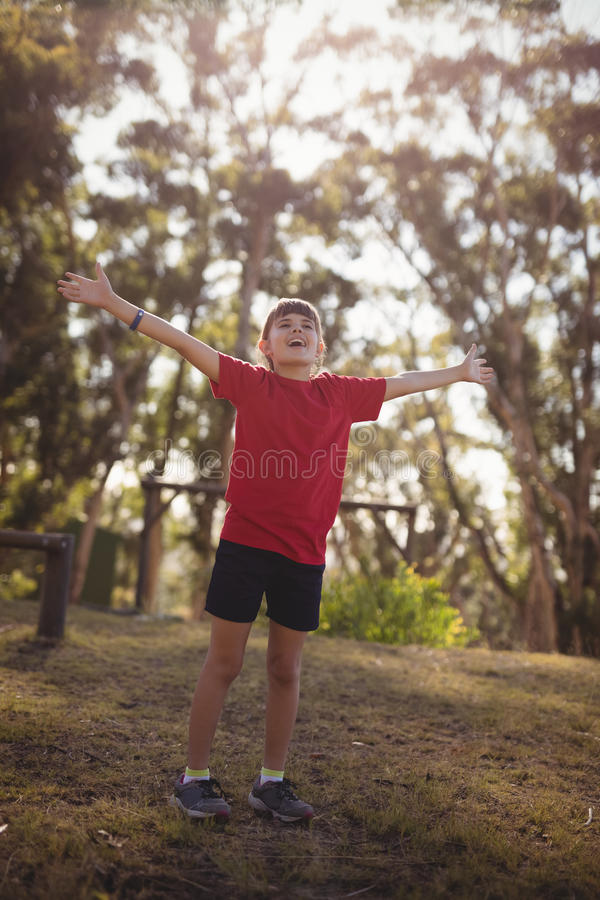 Happy girl cheering during obstacle course royalty free stock images