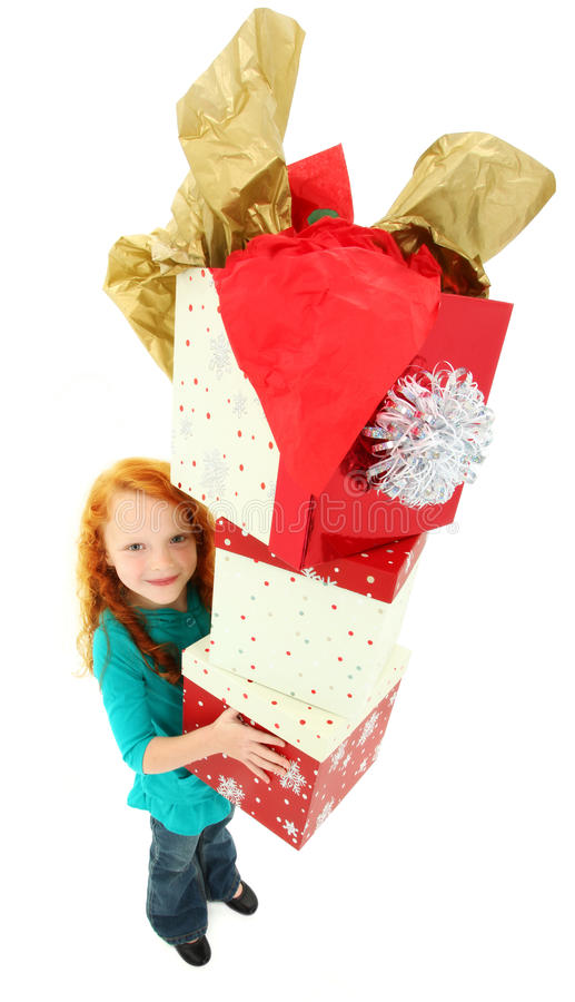 Happy Girl Child Carrying Stack of Gift Boxes stock photos