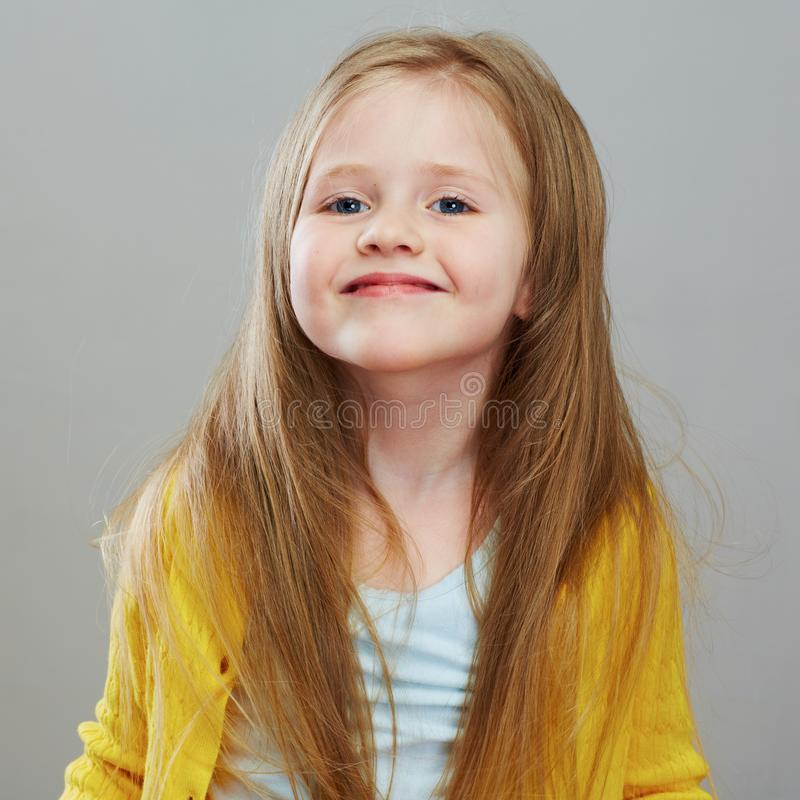 Happy girl child with long blond hair. royalty free stock photos