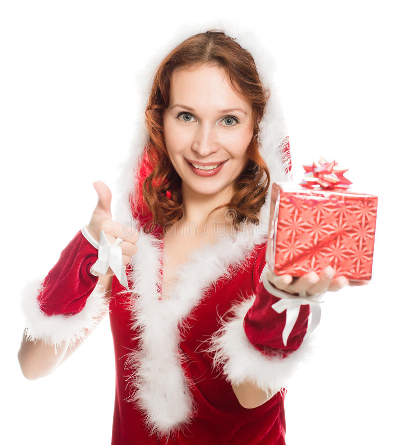 Happy girl in a Christmas dress showing okay sign royalty free stock photography