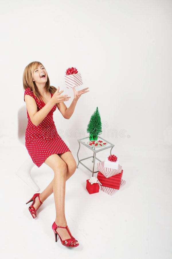 Happy girl with Christmas gift stock photo