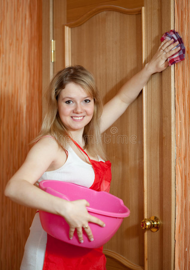 Happy Girl Cleans Furniture Stock Photography