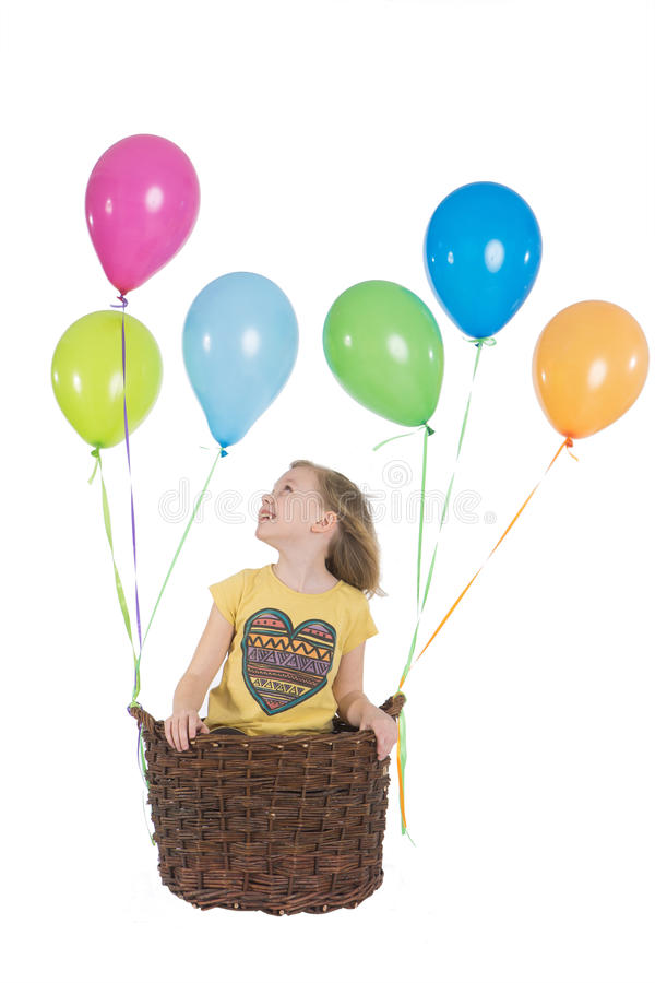 Happy girl with colorful balloons. Happy kid on hot air balloon royalty free stock image