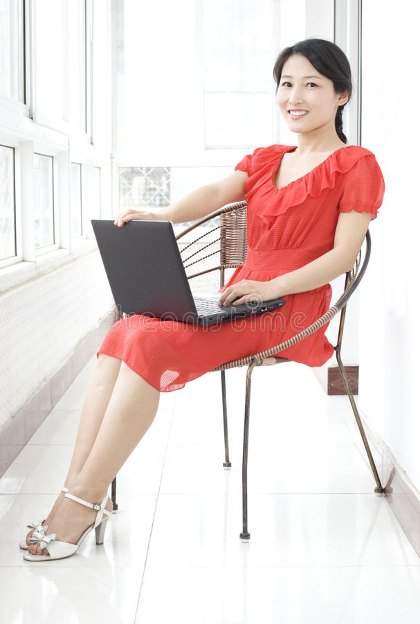 A happy girl and computer stock photos