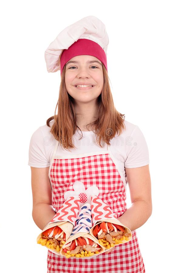 Happy girl cook with gyros on plate stock images