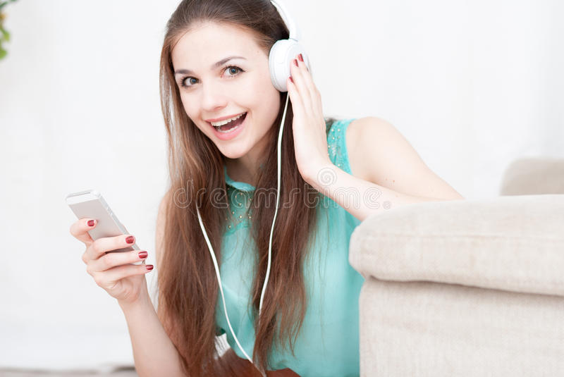 Happy girl on the couch at home stock images