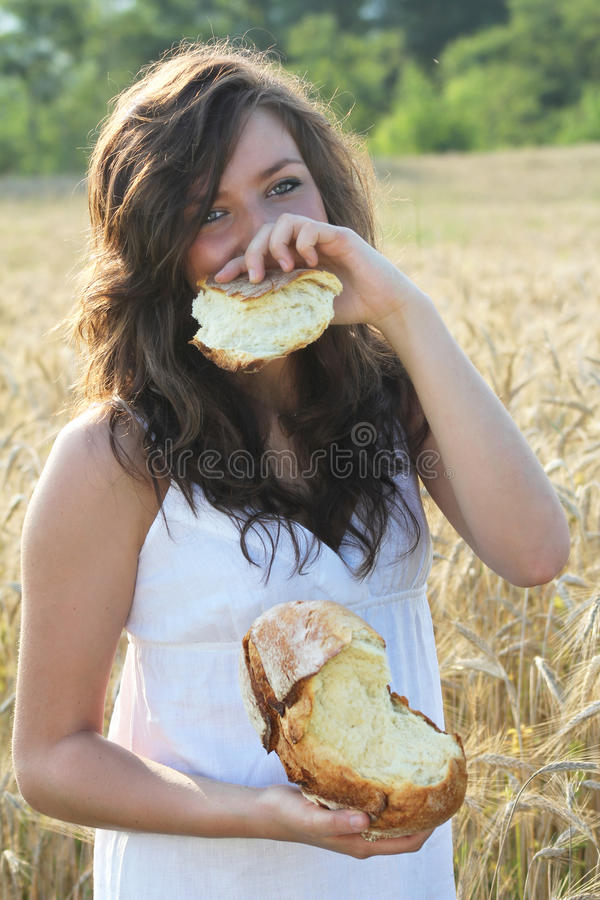 Happy girl covering her smile royalty free stock images
