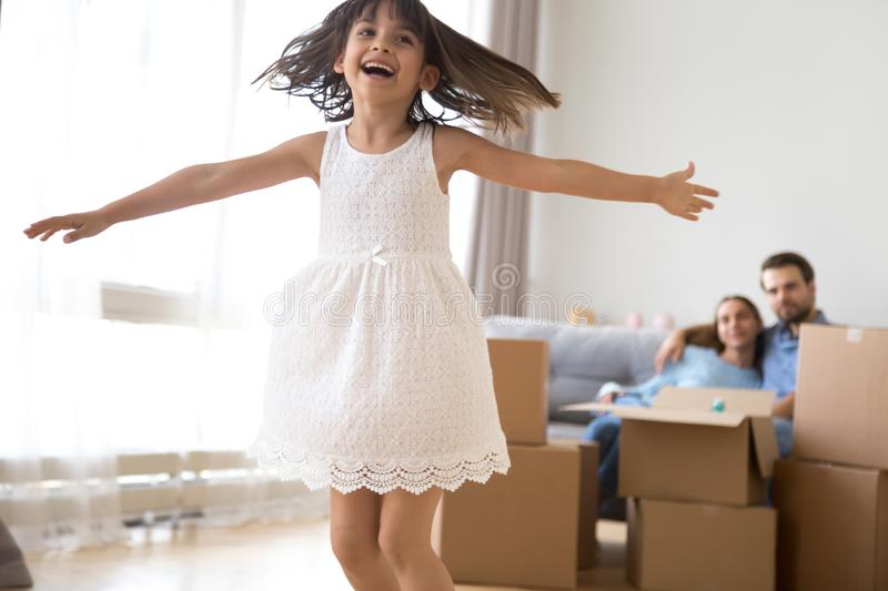 Happy girl dance excited moving to new home with parents royalty free stock photos