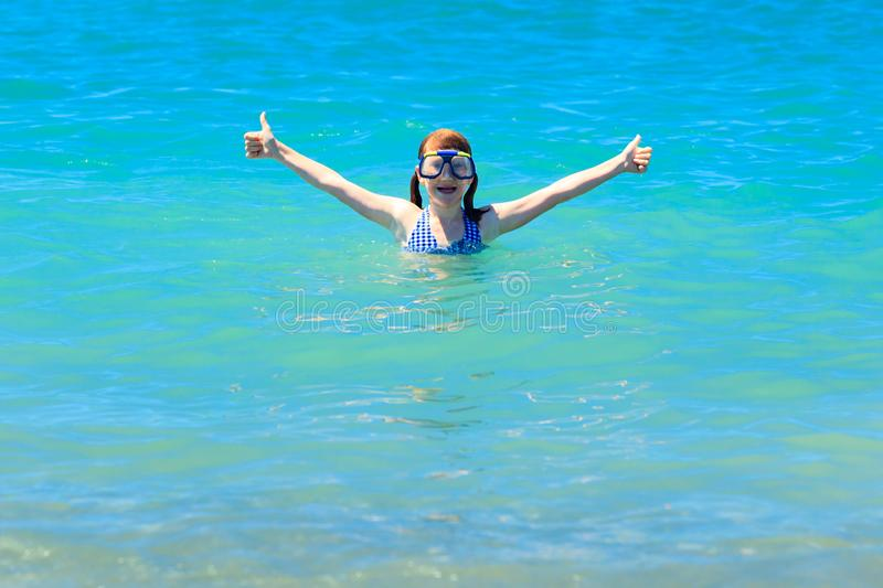 Happy girl in diving mask stock photo