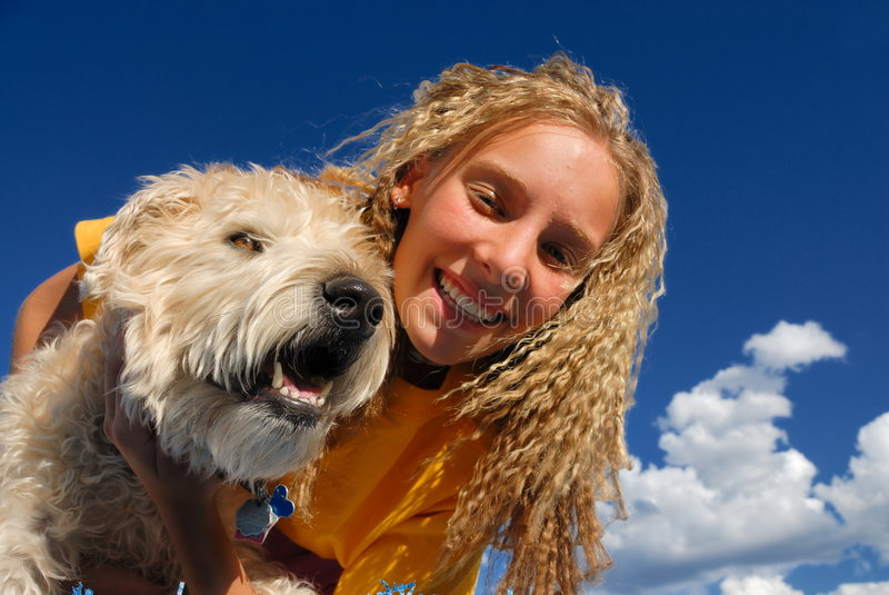 Happy girl with dog royalty free stock photo