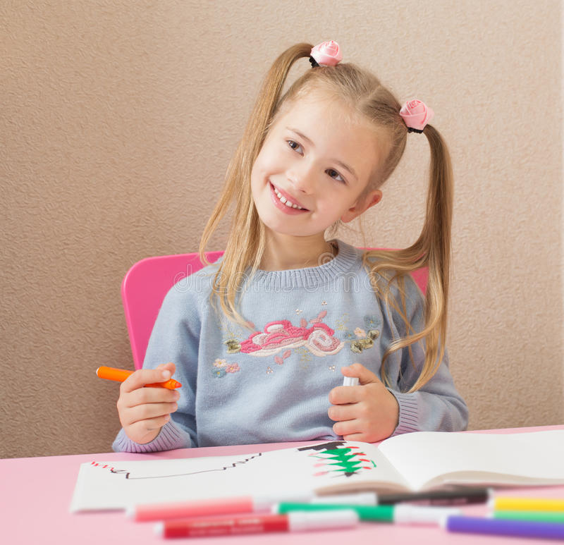 Happy girl drawing stock image