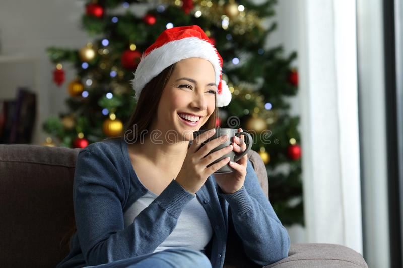 Happy girl drinking coffee in christmas at home stock photos