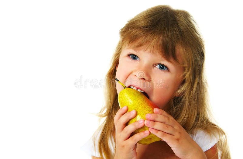 Happy girl eating green apple royalty free stock images