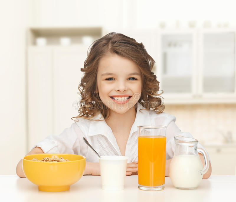 Happy Girl Eating Healthy Breakfast Stock Photo