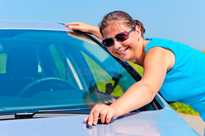 Happy girl embracing his new car royalty free stock photography