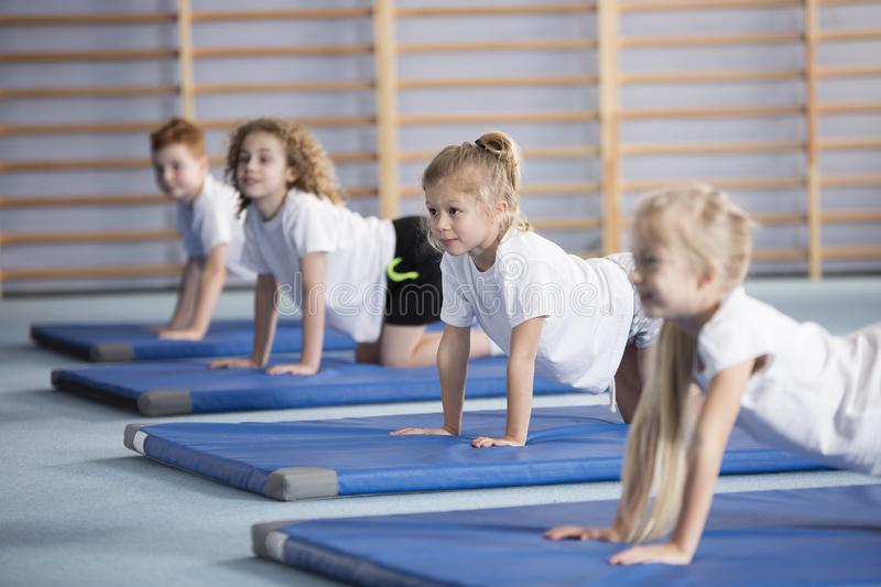 Happy girl during corrective gymnastics royalty free stock images
