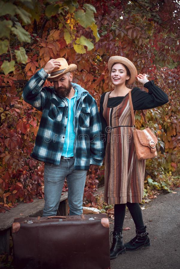 Happy girl fall in love with bearded man. Attractive couple having a romantic moment together, dressing in traditional stock photo