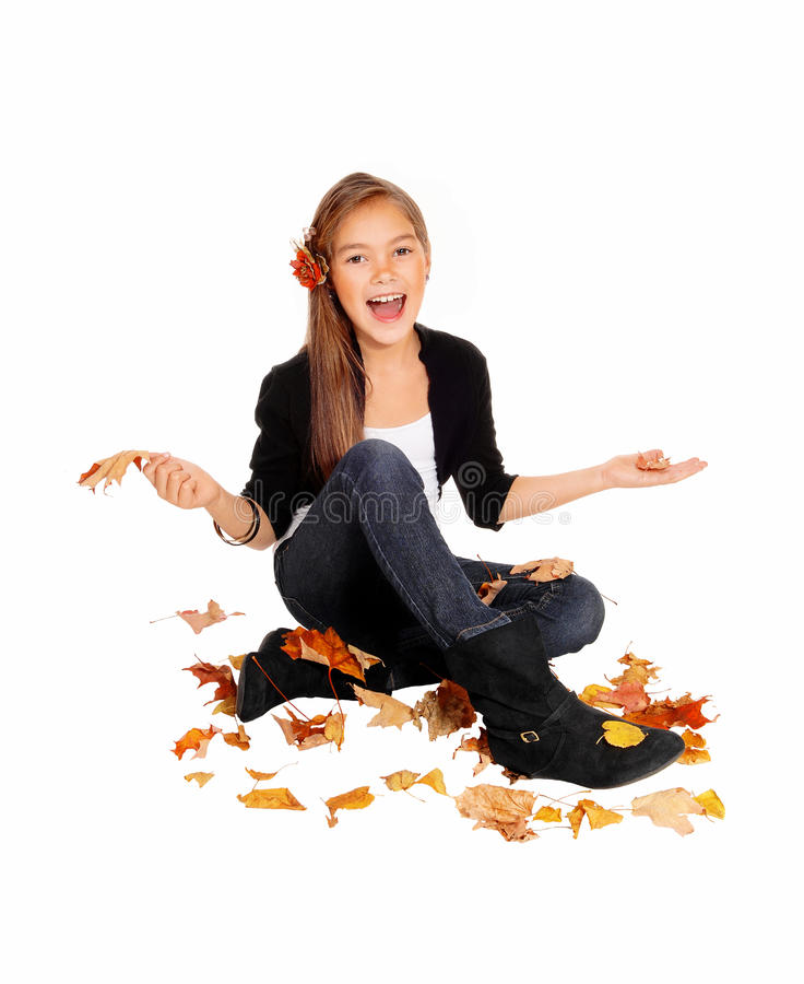 Happy girl with falling leaves. stock images