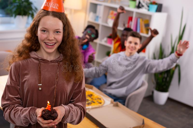 Happy girl feeling cheerful celebrating birthday with friends royalty free stock photos