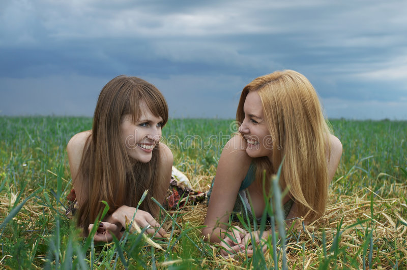 Happy girl friends stock photography