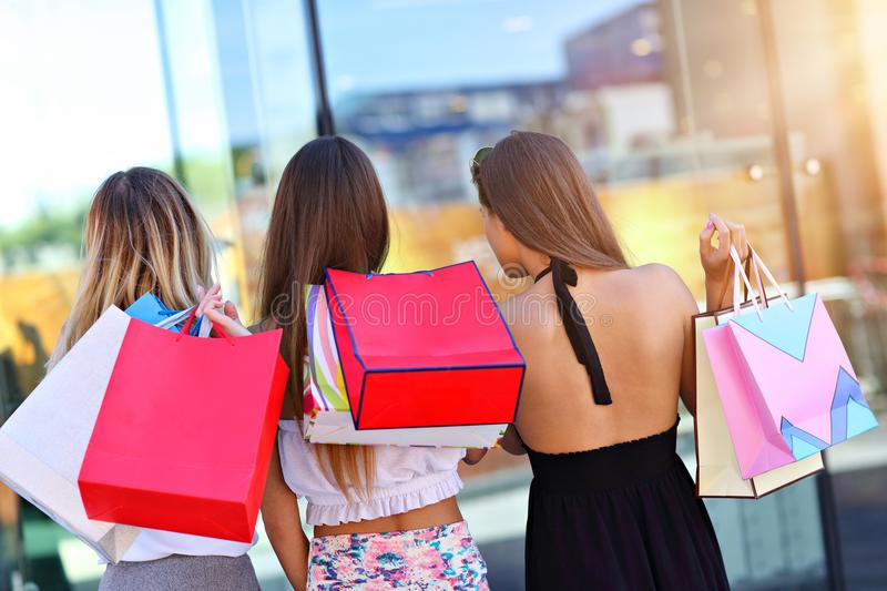 Happy girl friends shopping in mall royalty free stock image
