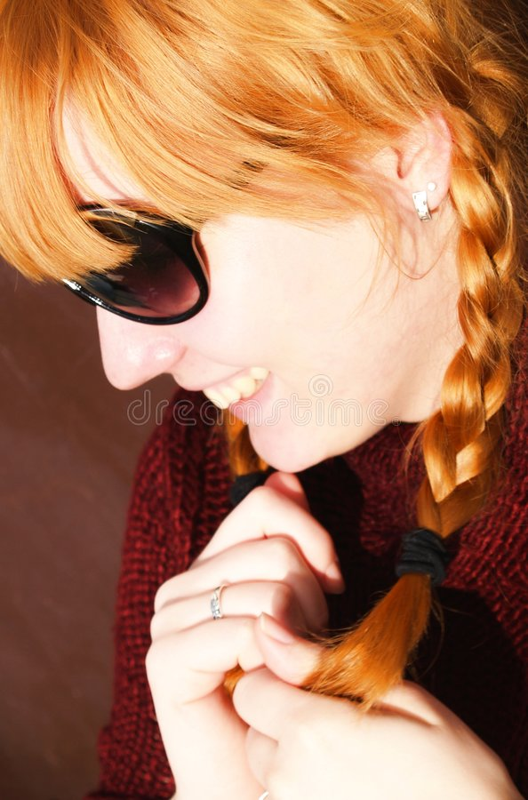 Happy girl with ginger hair royalty free stock photo