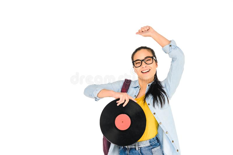 Happy girl in glasses holding vinyl record with hand above head isolated. On white stock images
