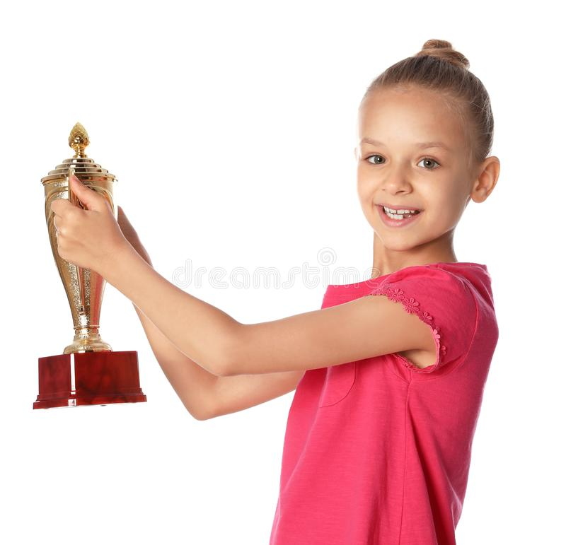 Happy girl with golden winning cup. On white background royalty free stock image