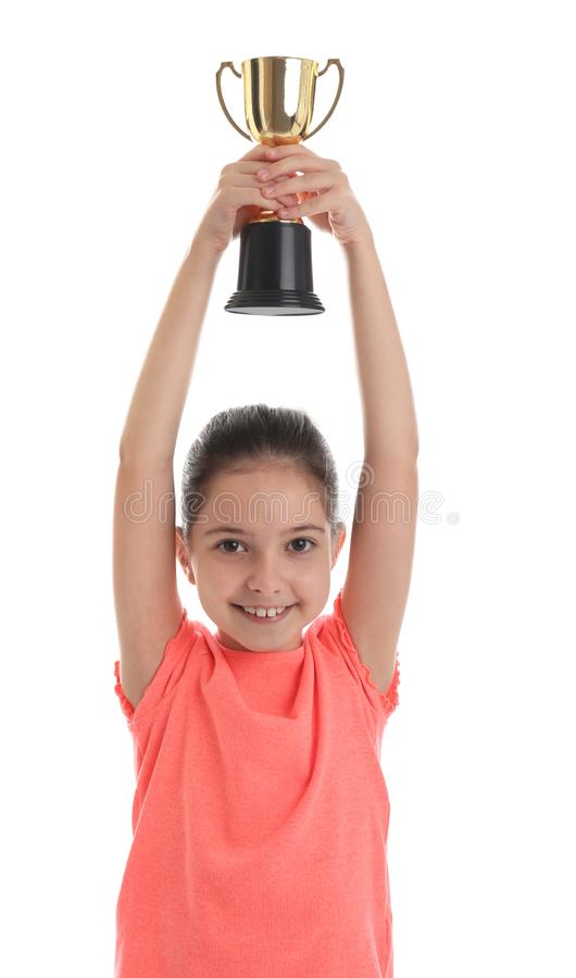 Happy girl with golden winning cup on white. Happy girl with golden winning cup isolated on white royalty free stock photo