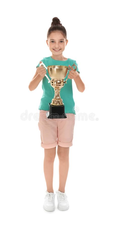 Happy girl with golden winning cup on white. Happy girl with golden winning cup isolated on white royalty free stock photos