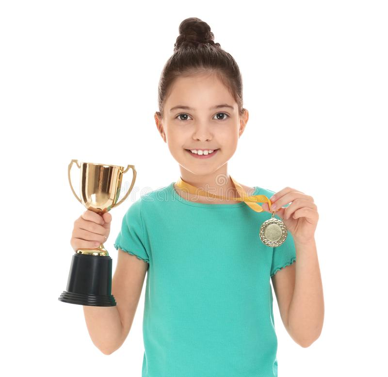 Happy girl with golden winning cup and medal isolated royalty free stock photo